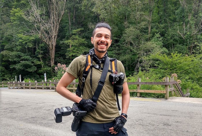 Sebastian Echeverri is outdoors with his camera gear for wildlife photography